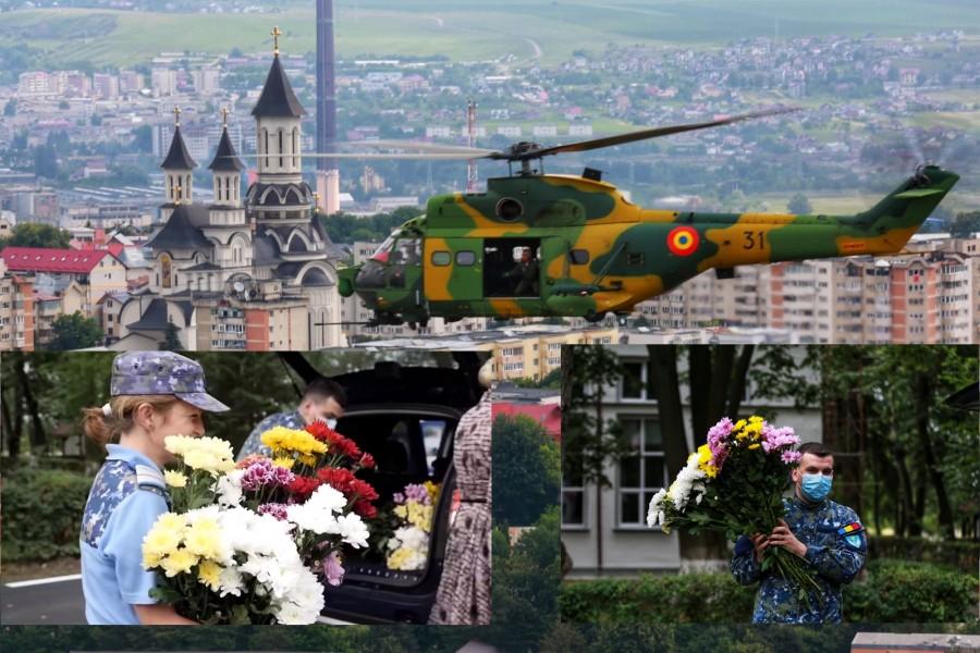 Flori pentru eroii în alb, lansate din aer deasupra spitalelor din Suceava şi Focşani
