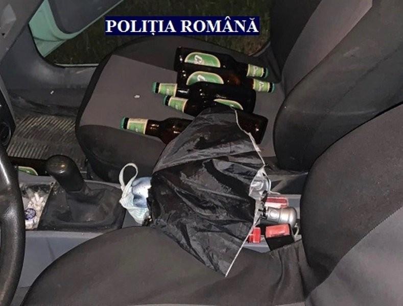 Băut și cu mașina plină de... sticle de băutură a fugit de polițiști